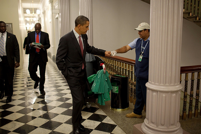 President Barack Obama fist-bumps custodian Lawrence Lipscomb.